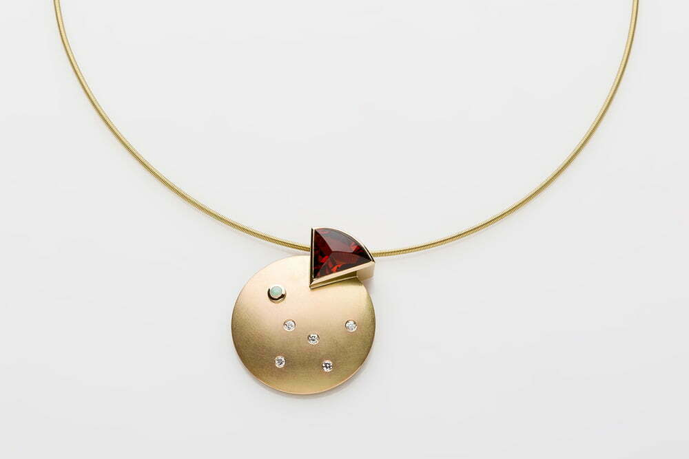 Montreal Jewelry Photography - Golden red stone necklace designed by Petra Luz